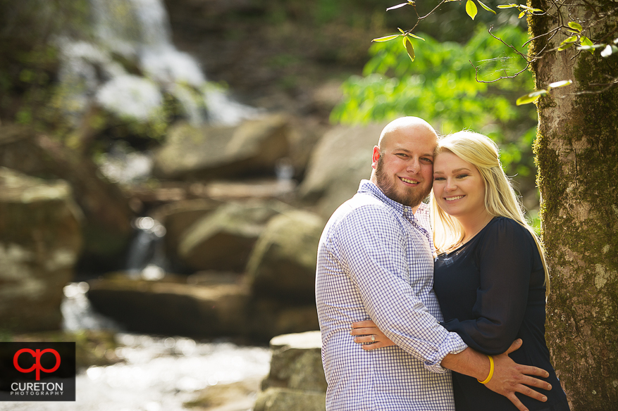 A couple cheek to cheek during their Pearson's Falls engagement session..
