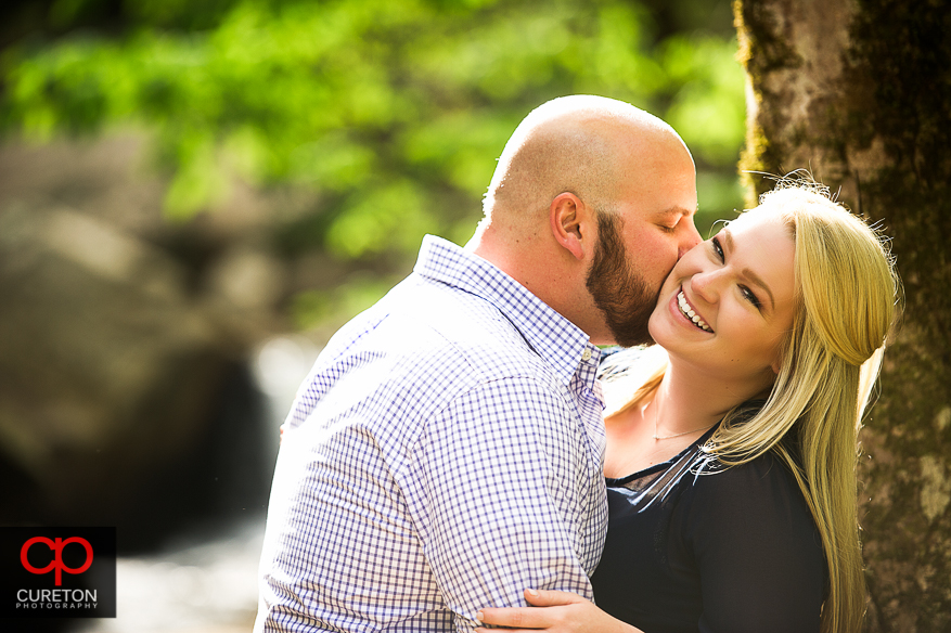A bride to be and her fiancee during an engagement session at Pearson's Falls.
