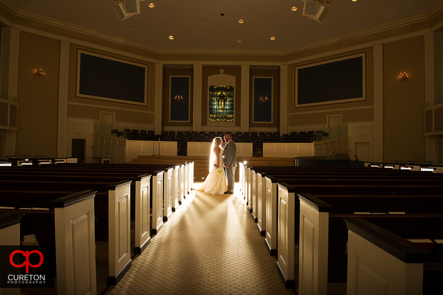 Married couple standing between the pews after the ceremony at Berea First Baptist Church.
