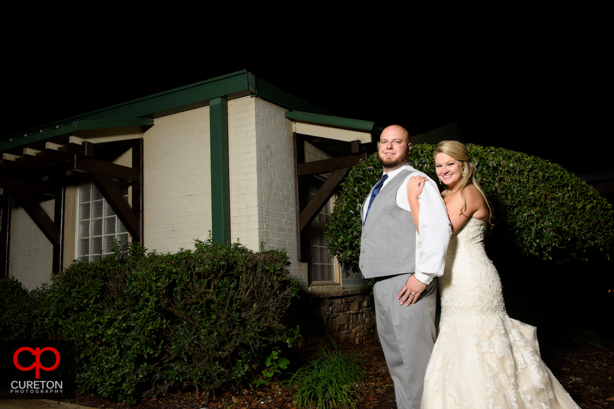 Married couple standing outside the sawmill.