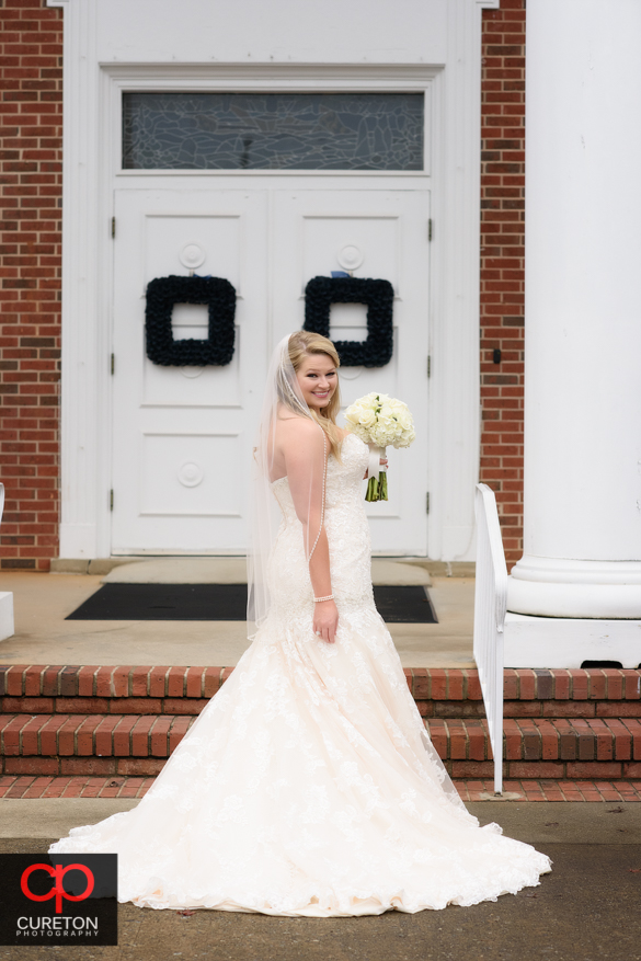 Bridesmaids in front of Berea First Baptist Church before the wedding.