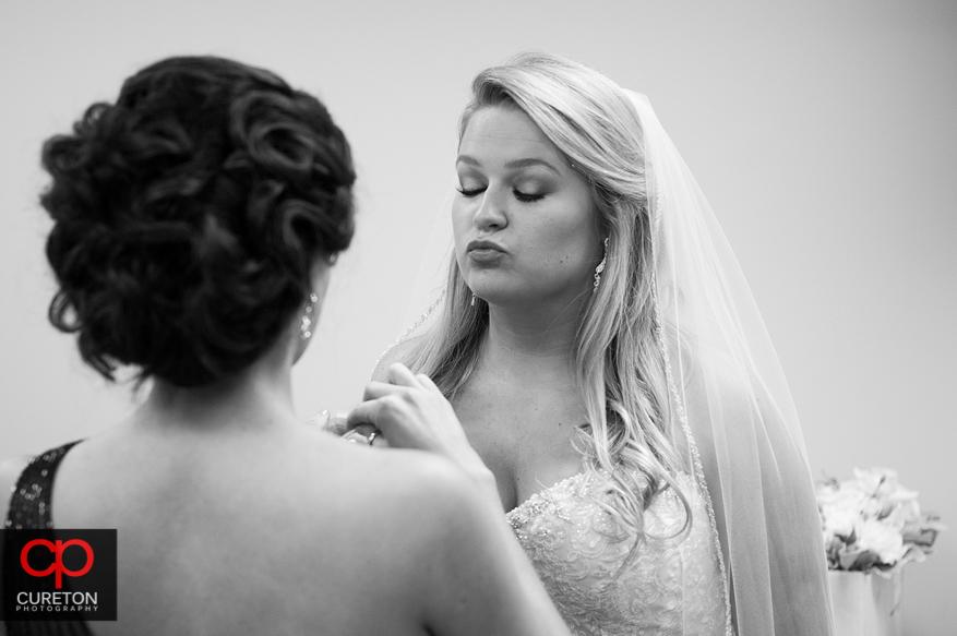 Bride taking selfies.