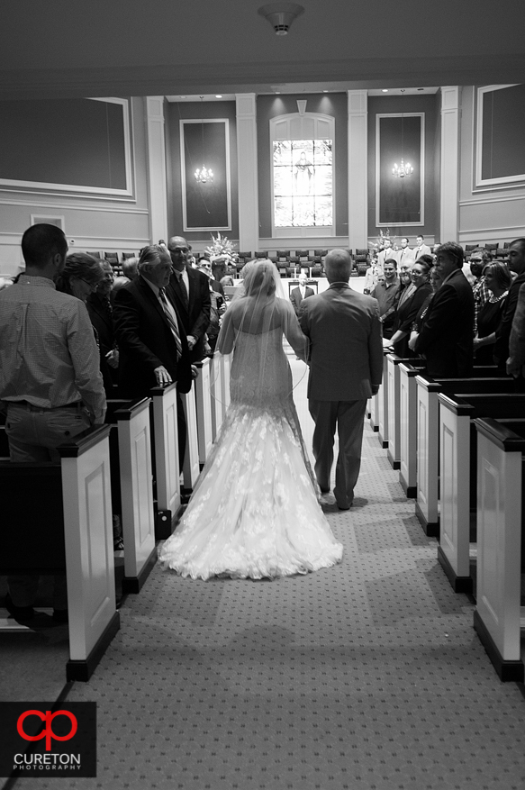 Bride walking down the aisle at Berea First.