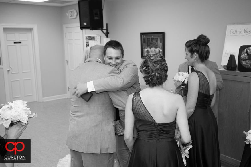 Couple congratulated after ceremony.