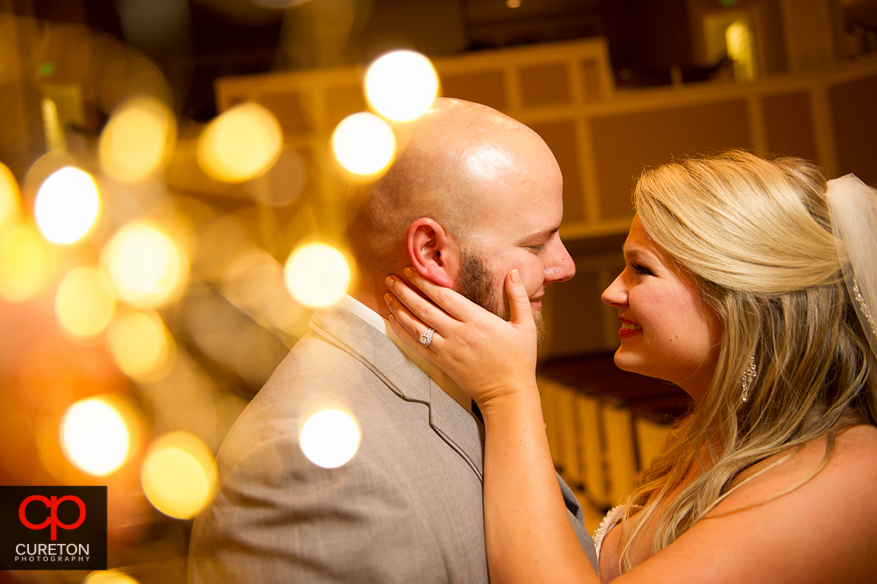 Cool shot of bride and groom with twinkle lights.