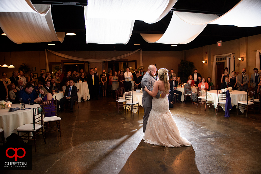 Bride and Groom share first dance.