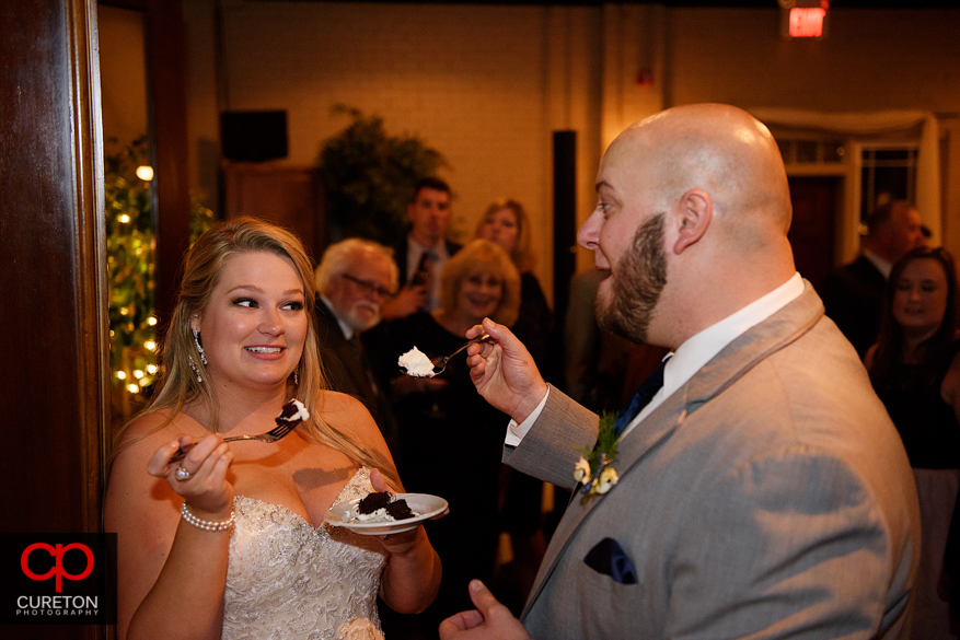 Bride and groom cut cake.