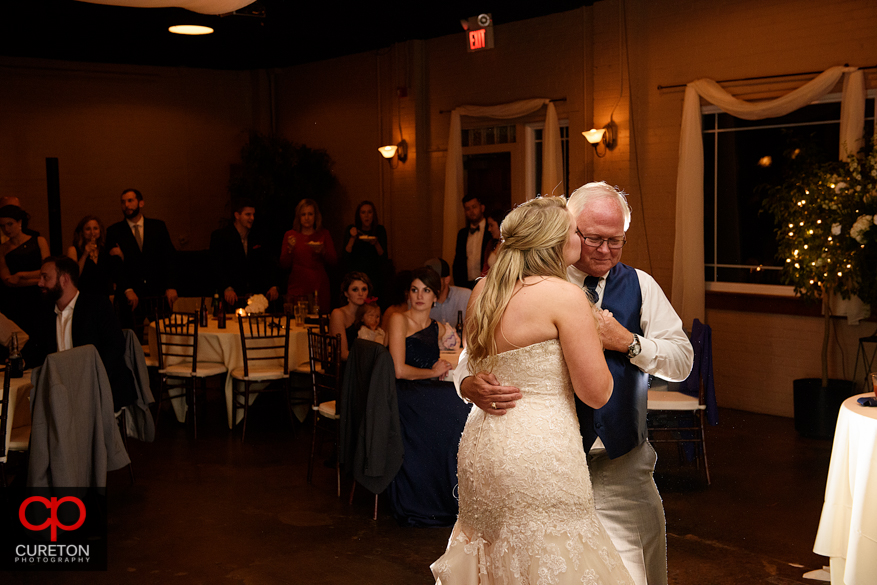 Bride dancing with er father at the reception.