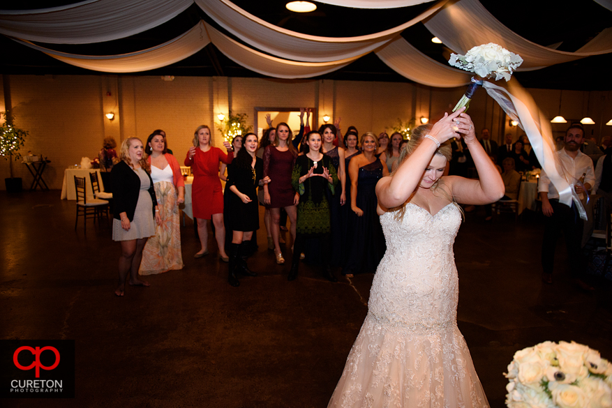 Bride tossing the bouquet .