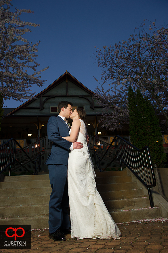 Bride ang groom kissing after their wedding at Cleveland Park in Spartanburg,SC.