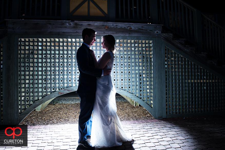 Backlit shot of bride and groom at Cleveland Park in Spartanburg,SC.