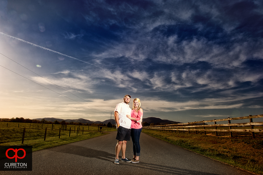 Couple in an amazing sunset during their Pearson's Falls engagement session.