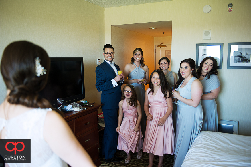 The bridal party sees the bride for the first time.