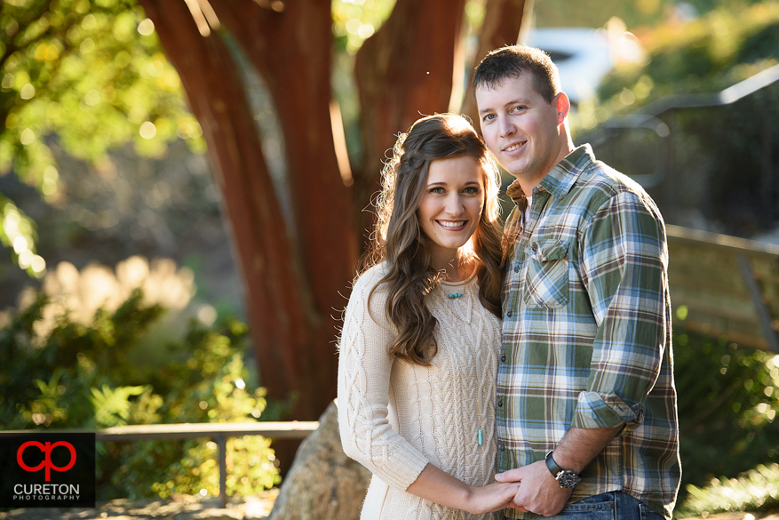 Soon to be married couple during a Falls Park Engagement session in Greenville,SC.