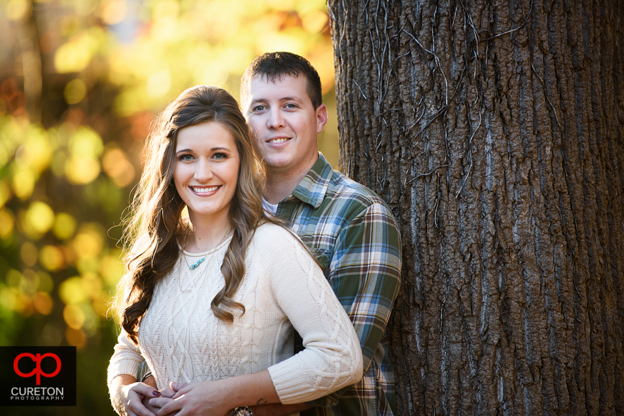 Couple during a fall season engagement session.