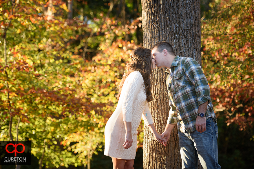 Fall leaves and an engaged couple.