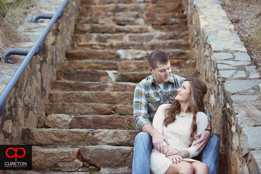 Couple sitting on the steps at Falls Park.