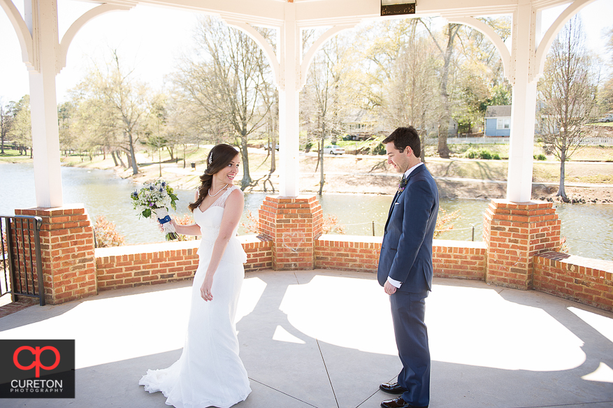 Bride twirls for groom during first look.