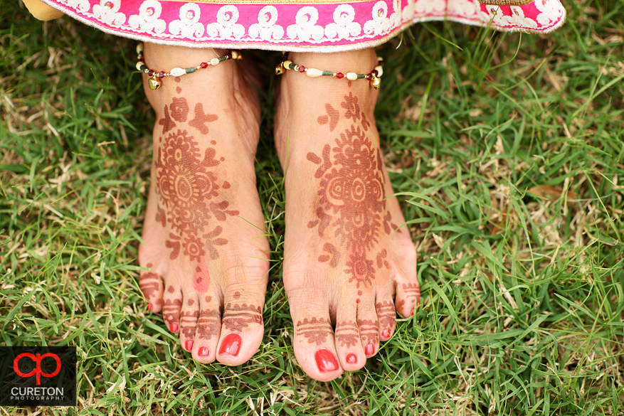 Indian bride showing off the henna on her feet.