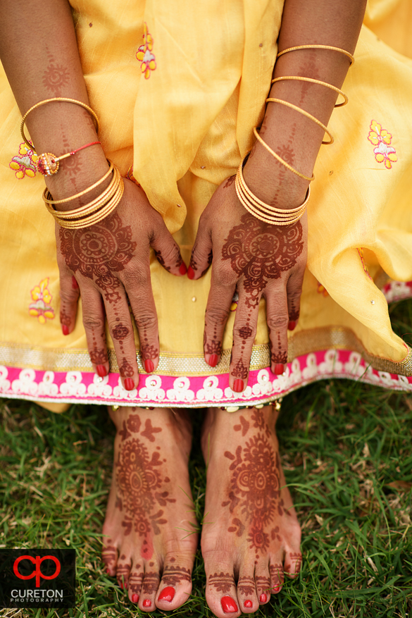 Indian bride showing her henna tattoo at her pre-wedding video.