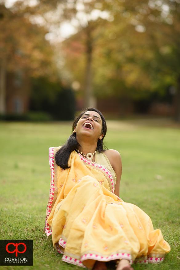 Indian bride laughing.