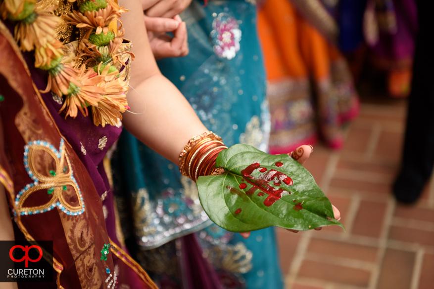 Family participates in a pre Indian wedding Vidhi ceremony at Presbyterian college.
