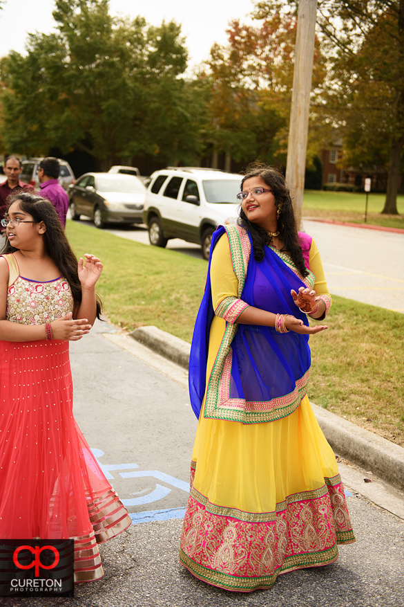 Indian family does garba outside the event hall.