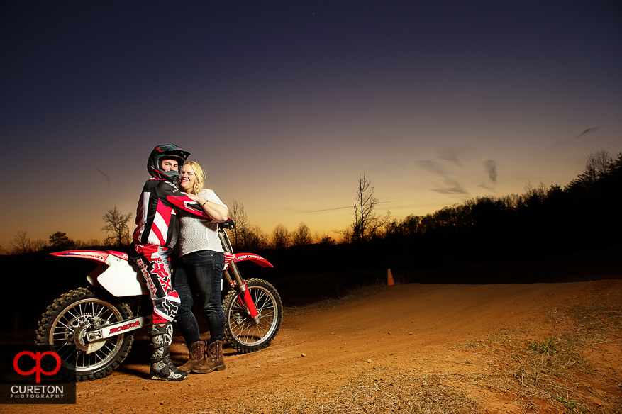 Couple on a motorcycle at sunset during an engagement session in Greenville,SC.
