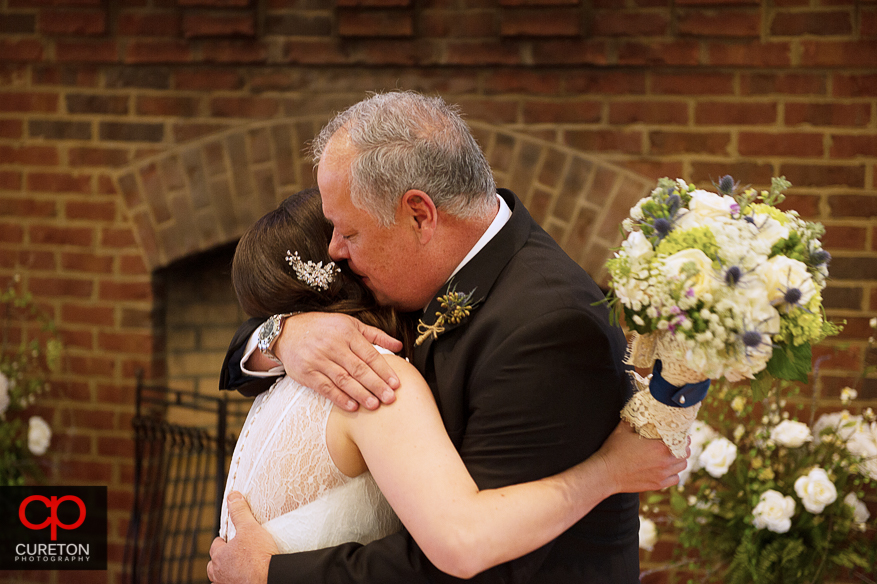 Brides father sees his daughter for the first time.