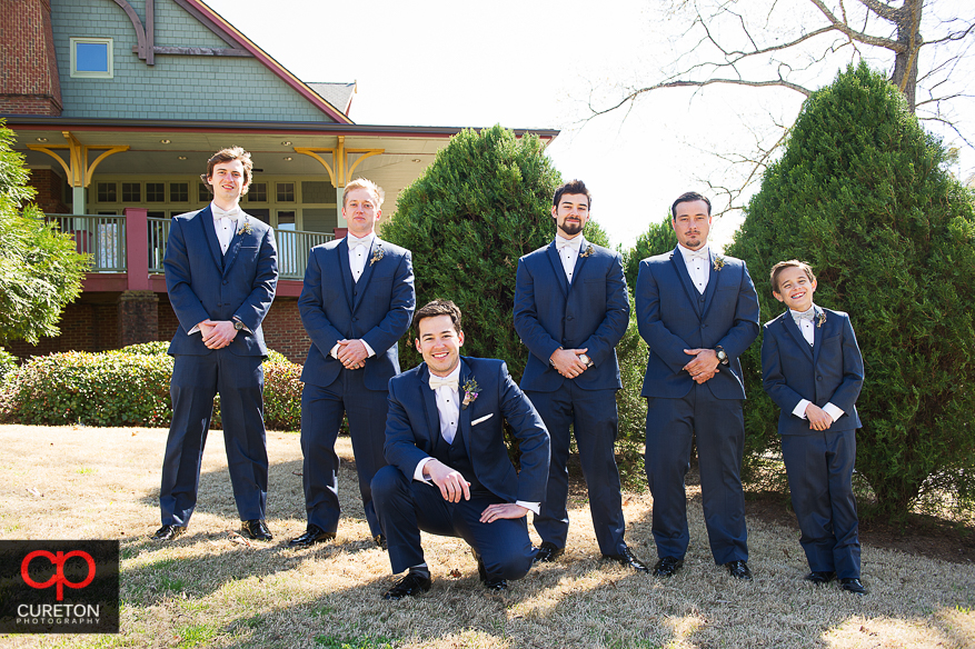 Groomsmen hanging out before the wedding in the park.