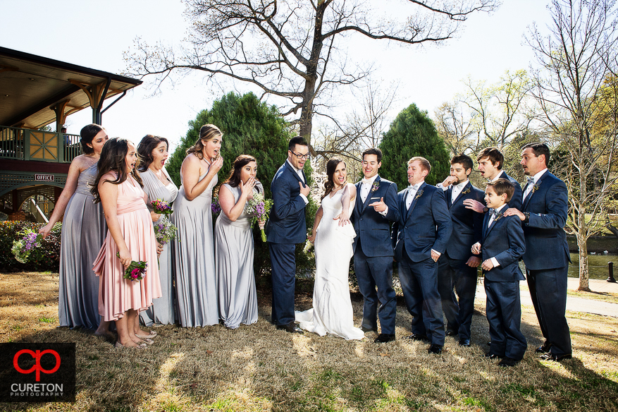 Bridal party in awe of the ring.