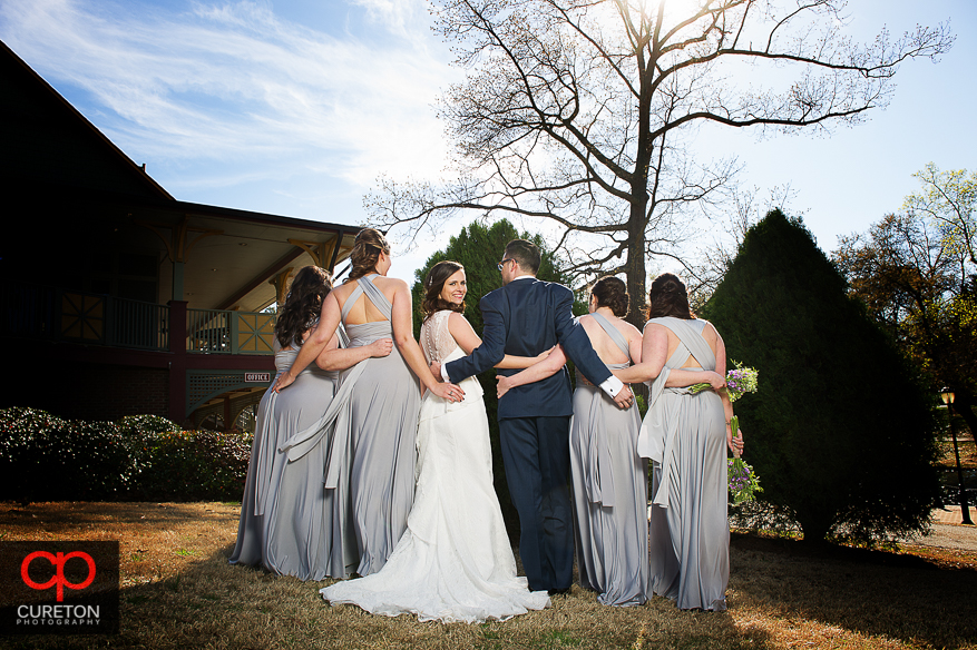 Bride and bridesmaids from the back.