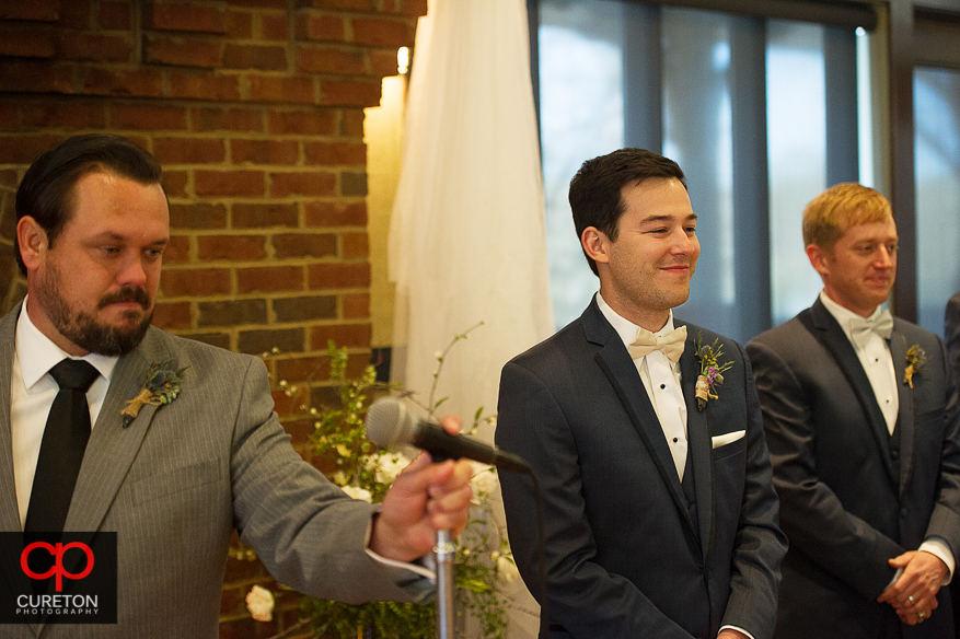 The grooms face when he first sees his bride.