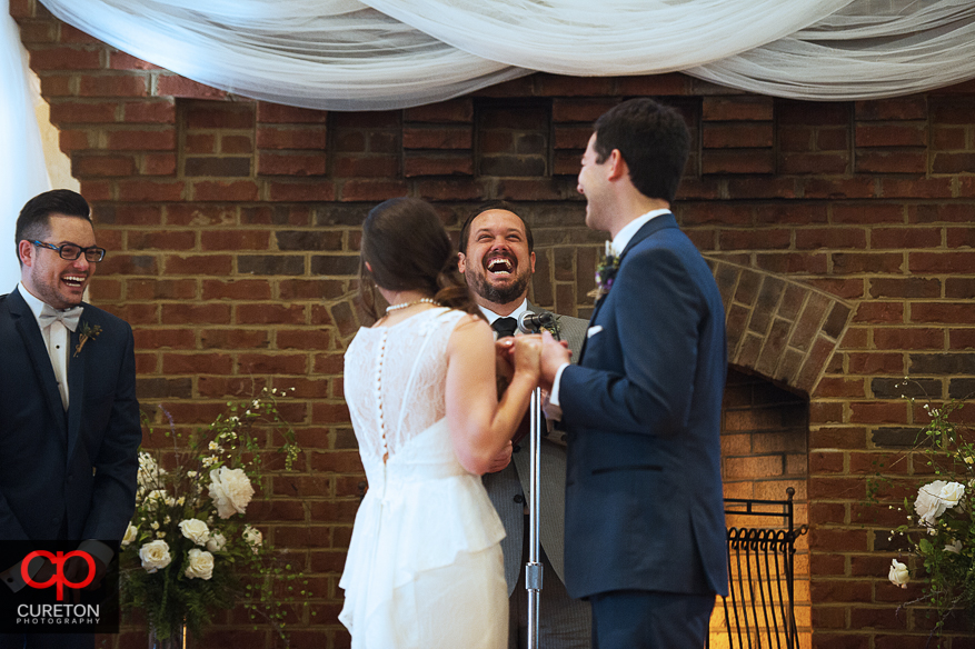 Officiant laughing during the wedding.