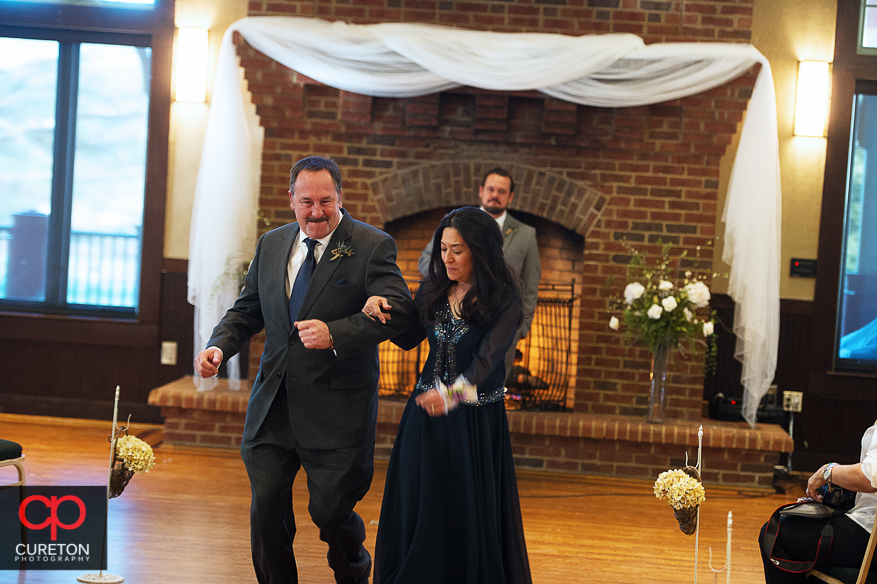 Grooms parents dancing up the aisle.