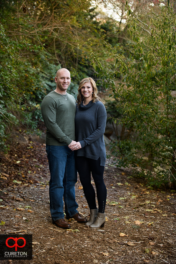 Fall in the rock quarry garden with an engaged couple.