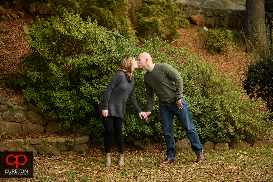 Couple during their engagement session at the rock quarry garden.