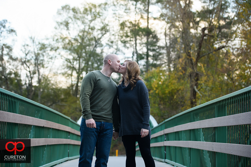 Engaged couple on the bridge at Cleveland Park.