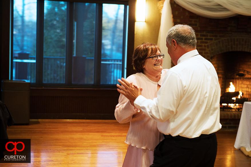 Brides parents dancing.