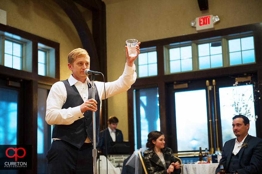 Groomsmen giving a toast.