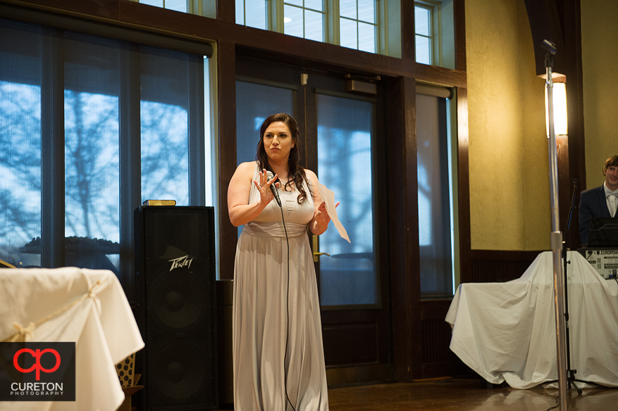 Maid of Honor raps her toast.