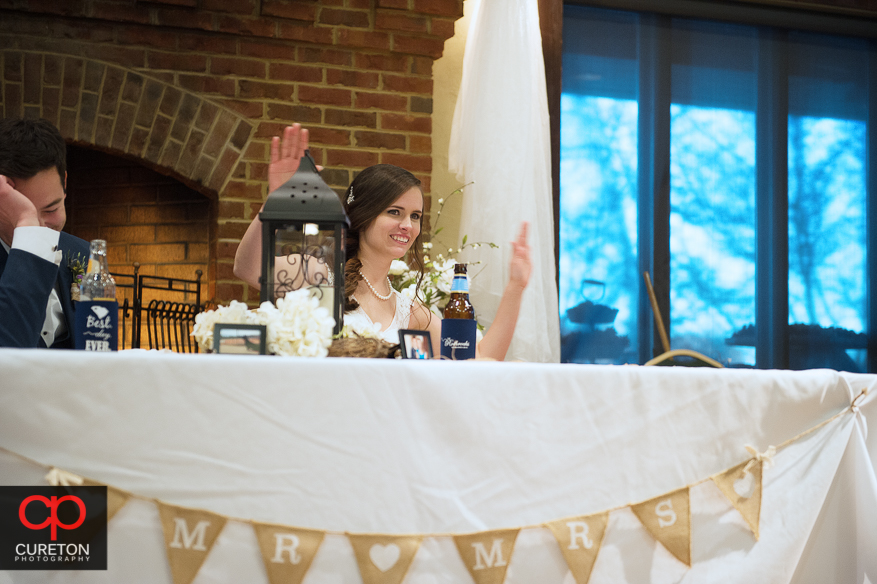 Bride dancing during the toast.