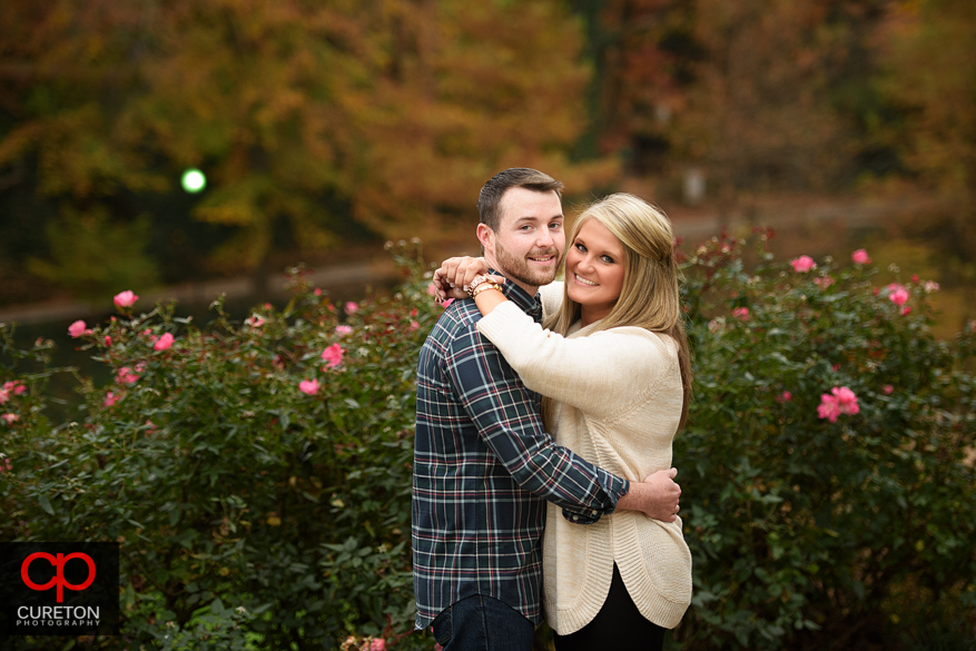 Engaged couple walking on a beautiful fall day in downtown Greenville,SC.