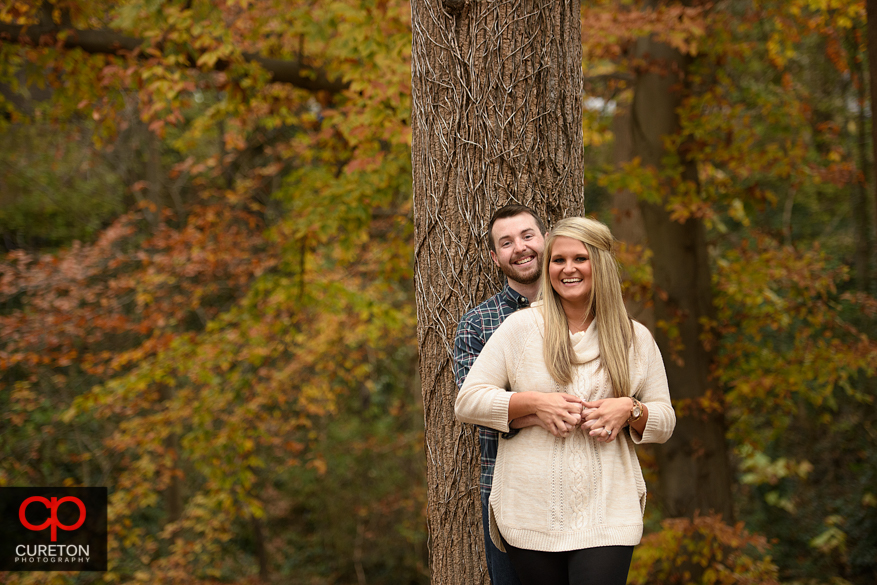Couple with a fall backdrop during a downtown Greenville engagement session.