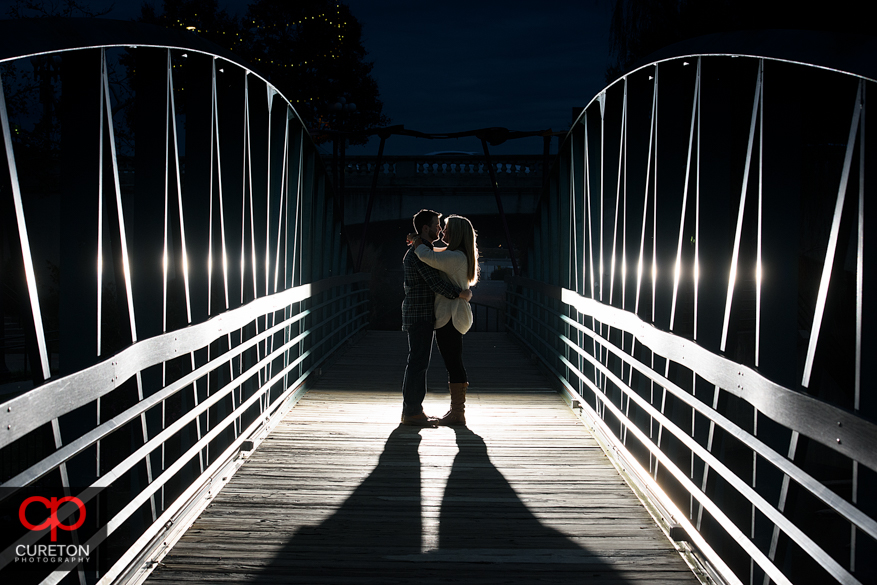 Backlit shot of a couple on a bridge in Greenville,SC.