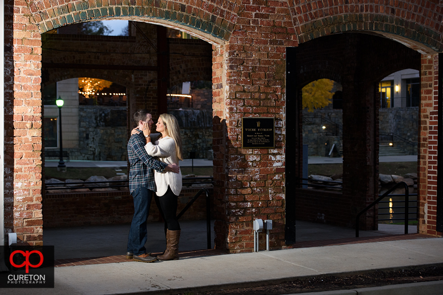 Soon to be married couple in front of the Wyche pavilion downtown.