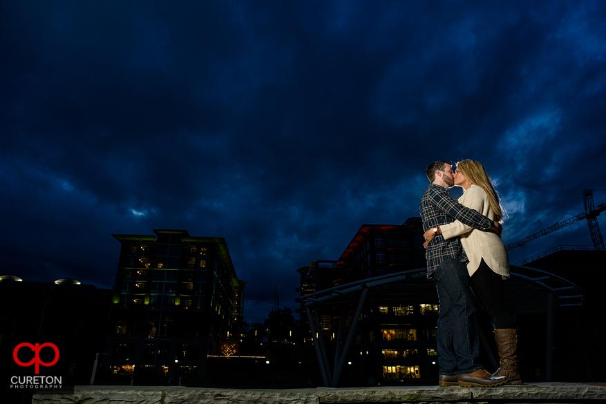 Epic deep blue sky backdrop as engaged couple dances.