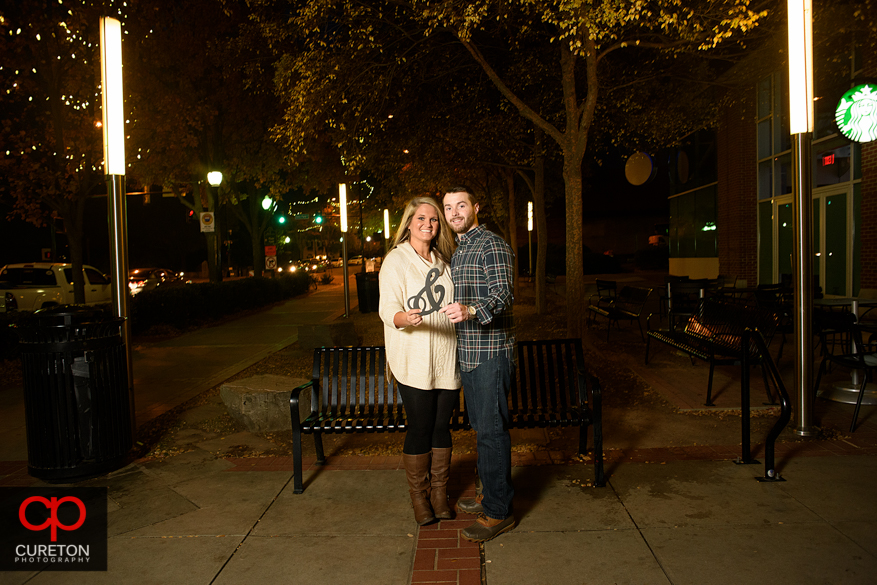 Couple standing on main st downtown.