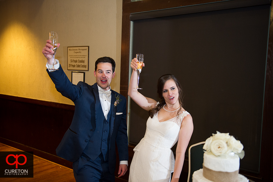 Groom and bride toast the crowd.