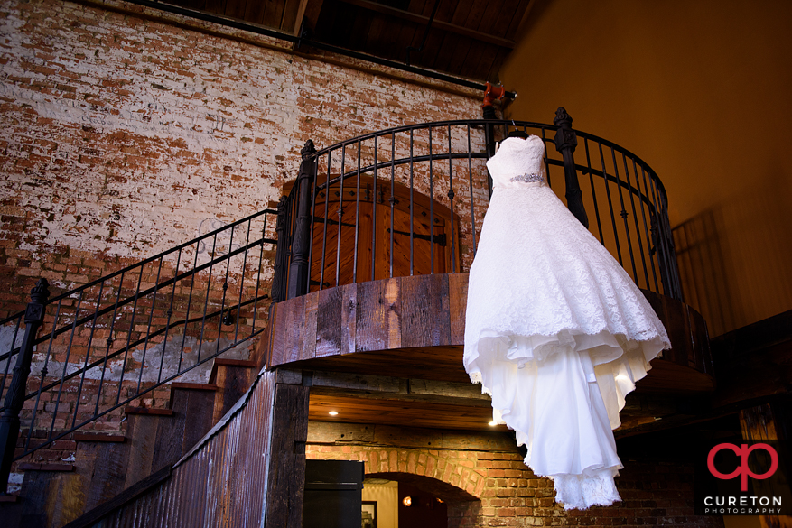 Brides dress on stairs.